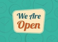 """Text reading """"We are open."""""""
