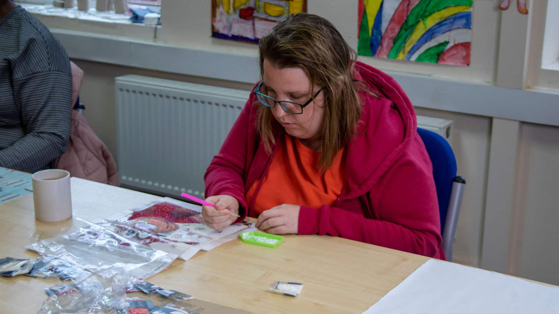 Service users working in the arts and crafts room