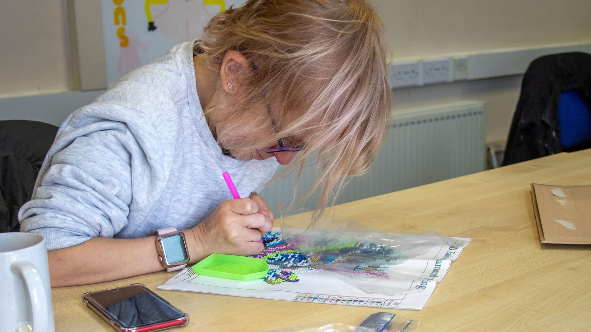 Service user working on a piece of art