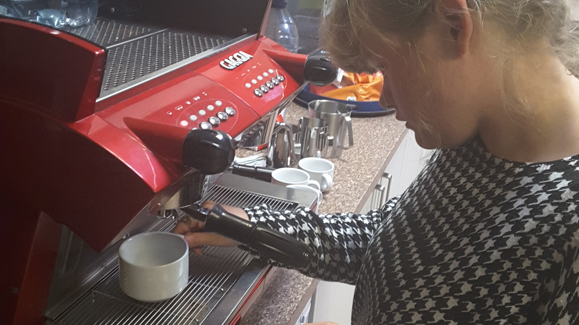 Magpies member using a coffee machine